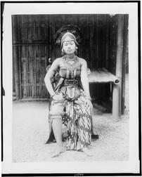 Female Javanese dancer, full-length portrait, seated, in costume, Paris Exposition, 1889