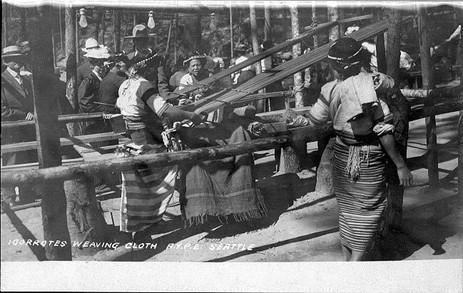"""Igorrote women demonstrating weaving techniques, Alaska Yukon Pacific Exposition, Seattle, 1909."""