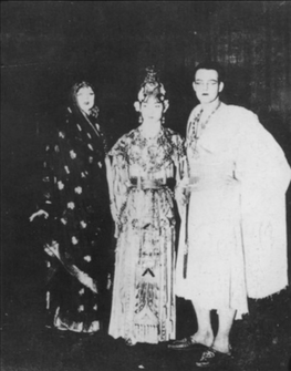 Mei Lanfang after his performance of Hegemon King Bids Farewell to His Concubine on stage with Ruth St Denis and Ted Shawn who also still had their costumes on. 1925 photograph.