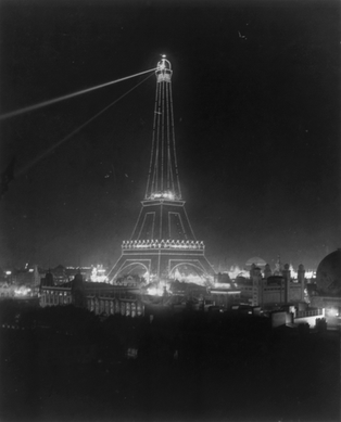 The Eiffel Tower at night during the 1900 Exposition.