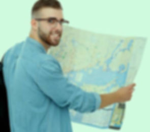 66106592-young-man-holding-map-on-white-