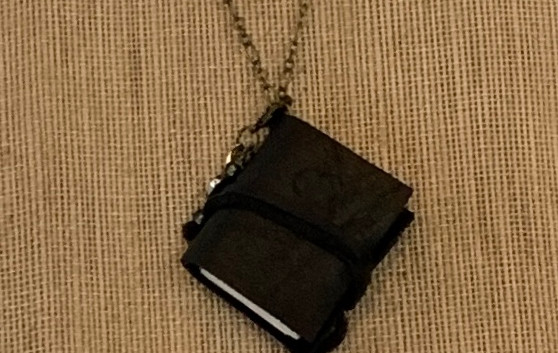 black journal necklace
