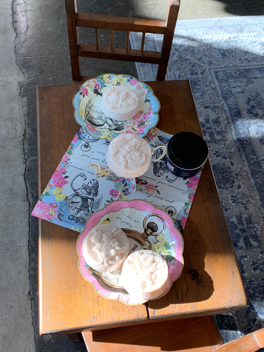 Alice tea party set up with Queen of Hearts candles and White Tea soap