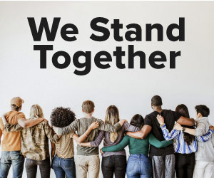 We stand together, people holding each other in unity