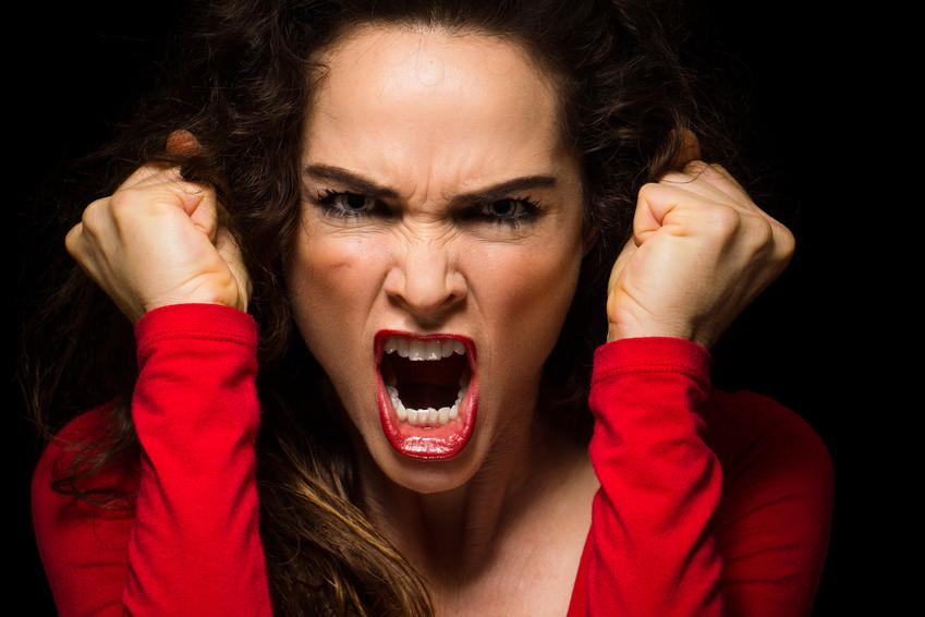 Women wearing a red shirt and shouting