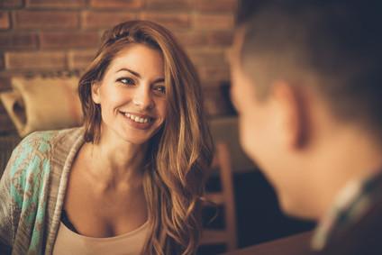A women smiling at a men