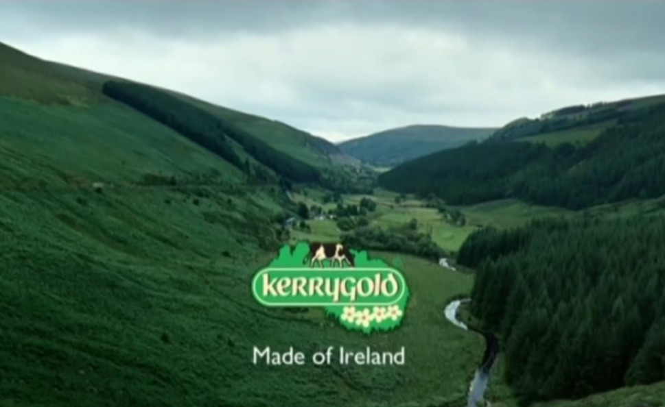 An image of a lush Irish landscape behind the Kerrygold logo and the slogan, 'Made of Ireland'. The logo features a black and white cow and four daisies on a green background.