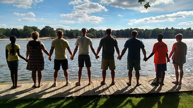 Teens with back towards camera on dock holding hands.jpg
