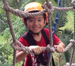 Small smiling asian child on ropes_edited_edited.png