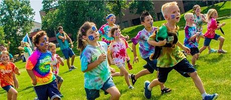 KIDS RUNNING IN TIE DYED SHIRTS_edited.jpg