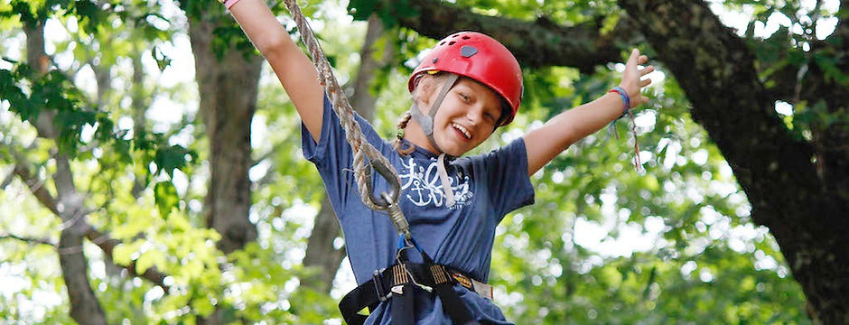 HIgh ropes girl smiling outstretched arms_edited.jpg