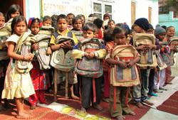 Kids show off free backpacks.