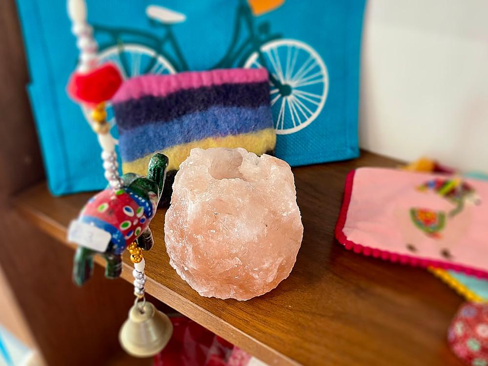 Close-up of tea-light candle holder, made out of rose pink rock salt.