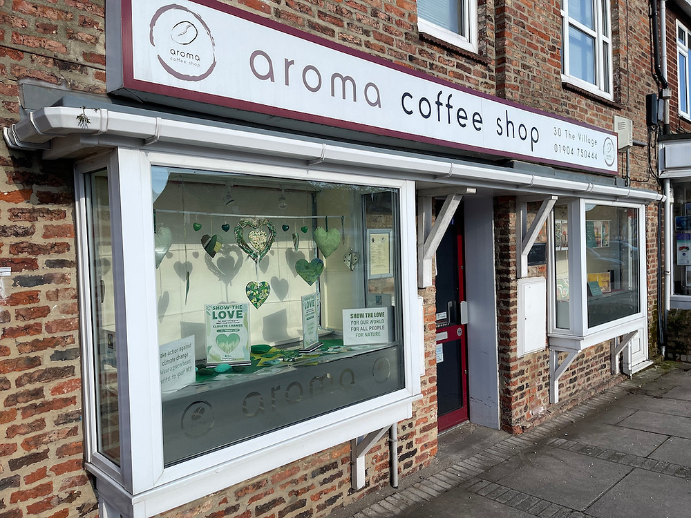 The shop windows at Aroma, showing the Green Hearts Display.