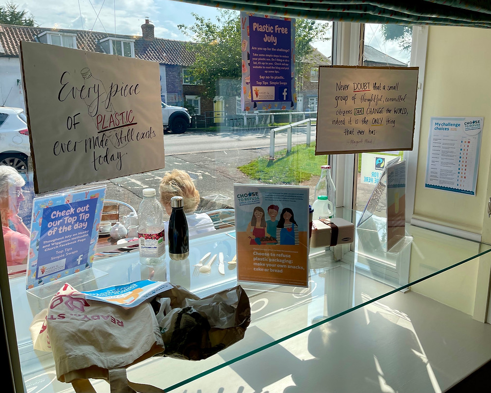 Inside view of our window display highlighting plastic pollution and promoting Plastic Free July.
