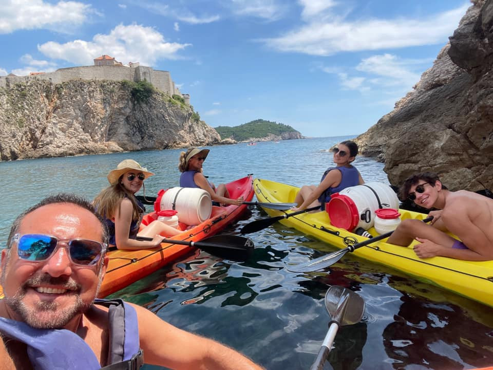 Kayaking around Dubrovnik city wall.