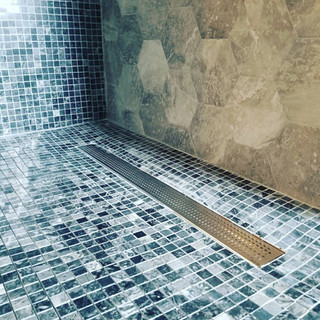 Grate drain and shower installation