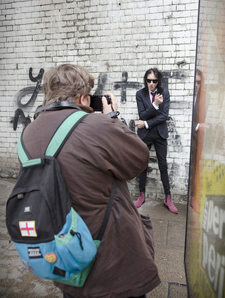 Student Harry Yeates photographing John Cooper Clarke.jpg
