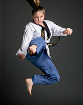Teenage taekwondo jumping front kick
