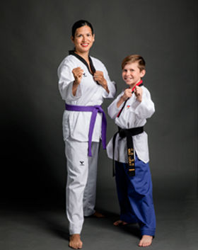 Mother and son in taekwondo family class