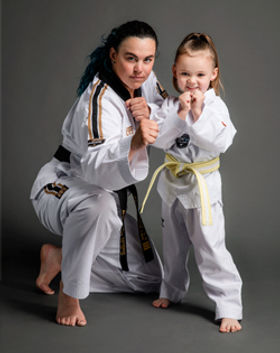 Taekwondo child and instructor