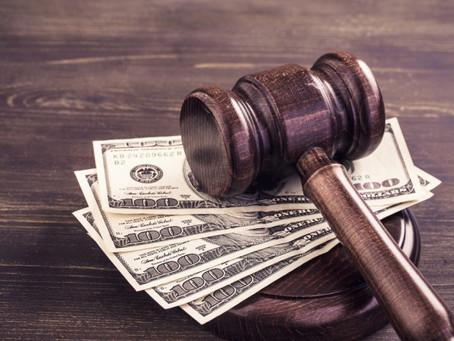 Demissão com contrato suspenso ou reduzido enseja indenização