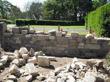 Rubble wall built to courses underway