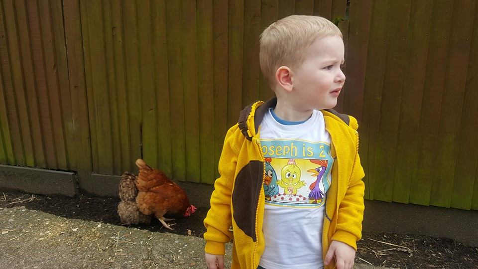 Josep at a city farm with some chickens in the background