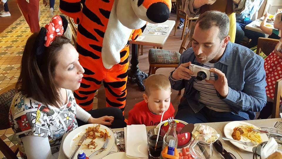 We are blowing birthday candles with Tiger at a restaurant at Disneyland Paris