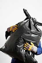Clean up around the house or yard with trash removal.