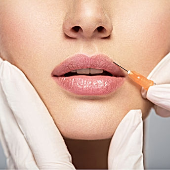 young woman gets injection of botox in h