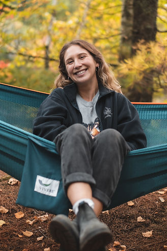 Founder and Tour Guide Lisa Smiling in a Hammock on a Beautiful Fall Day