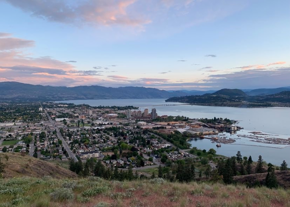 Peaceful views from above of Kelowna's downtown core, surrounded by the mountains and lakes of the Okanagan Valley