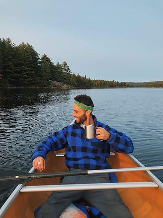 Tour Guide Mitch Enjoying a Morning Coffee in a Canoe