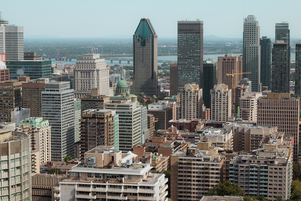 The views of the city of Montreal and its many skyscrapers from the top of a hill