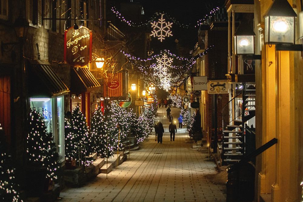 Winter Walk Through lit up cobblestone streets while traveling in Quebec