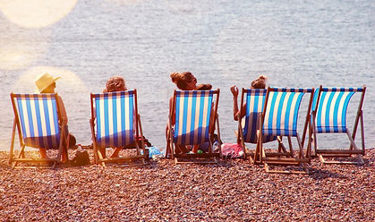 Canva - Four People On Lounge Chairs Nea