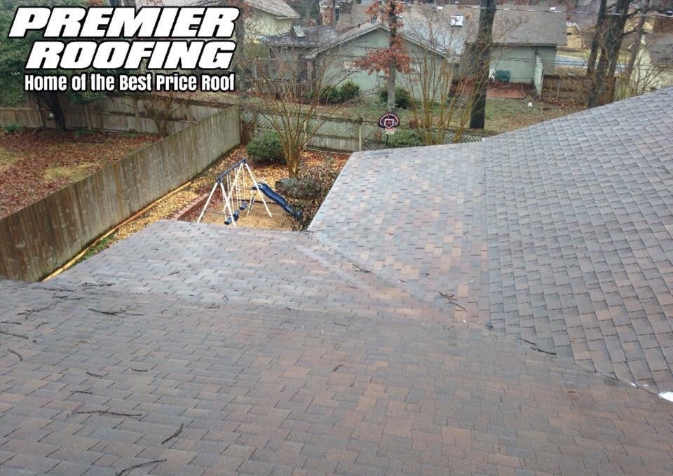 Before picture of shingles on a flat roof.