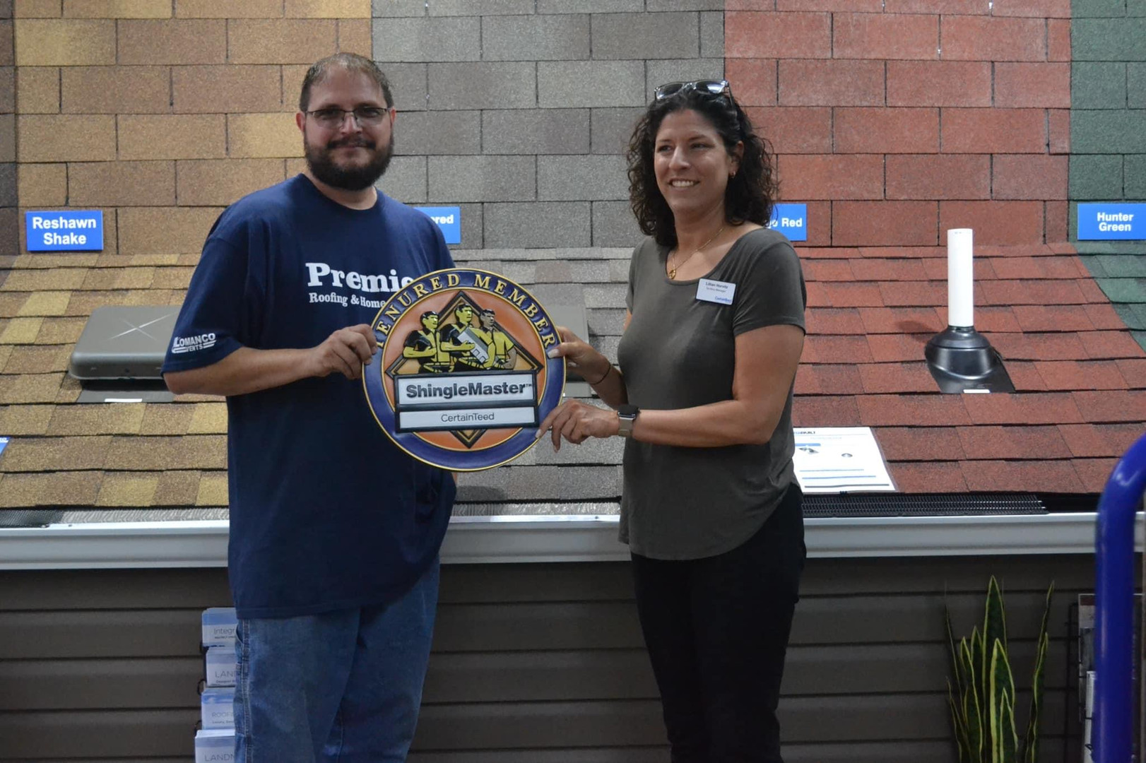 CertainTeed Roofing Products Presenting Premier Roofing, llc With The Tenured Certified Installers Certification Award.