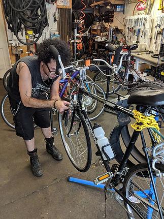 patron working on his bike.jpg