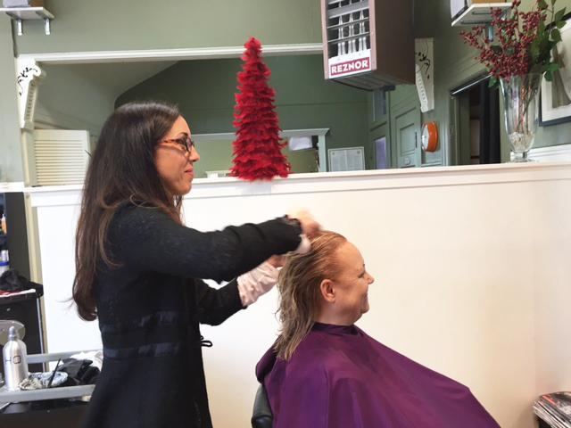Cow Hollow Hair Stylist Cutting Hair