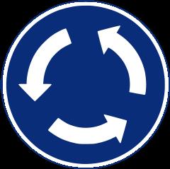 R-402 Intersección de sentido giratorio-obligatorio.