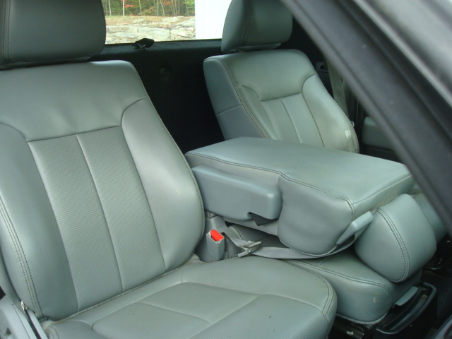 2011 Ford F-150 pass seat arm rest down.