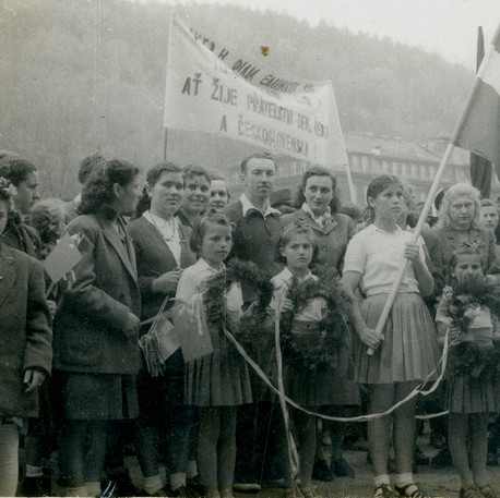 "The Greek Civil War refugees holding a Greek flag (the flag was in use until 1978 when a new one was introduced) and a poster saying ""Long live the friendship between Greece and Czechoslovakia"". Photographed in the Czech Republic.  Image found in ASKI archives, Athens, used with their permission."