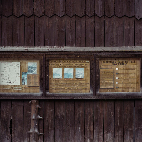Faded photographs, directions and maps for tourists venturing out for hikes in the mountains.