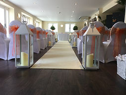 Tall white lantern for wedding ceremony