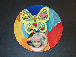 Children's art on a plate with photo