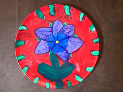 School child paint on a plate