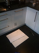 recommended handyman fix integrated dishwasher door