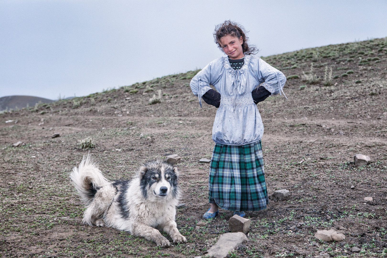 Kardelen and Her Dog. Dogs protect people at the highland against dangers. Kesis Plateau, Van. July 2012.